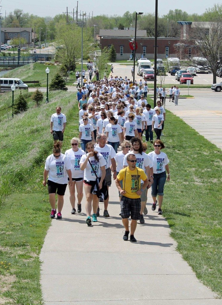 """Activate Buffalo County coalition member Bryce Abbey leads the way as Buffalo County workers """"walk out on their jobs""""."""