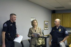Century 21 Property Manager Alexis McNeal speaks with Chief Lynch and another officer after the meeting.