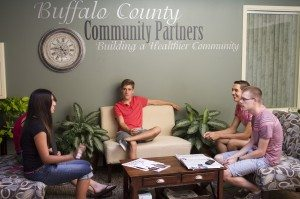 One of the breakout groups at the YAB meeting discusses potential community service projects.
