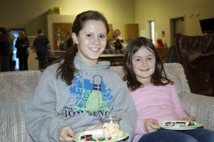 """YAB member Holly Dethlefs spends time with her """"little friend"""" at a mentoring event."""