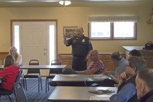 Kearney Police Chief Dan Lynch discusses after-Cruise Nite activities with local landlords, property owners, and citizens.