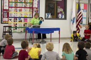 YMCA's Child Care Director Sue Klein presents the 2nd Step curriculum to youth through a puppet show.