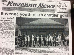 Members of Youth Advisory Board cut the ribbon signaling the completion of the first stage of the Bluefay Headquarters Youth Center on Friday. --Ravenna News September 2004