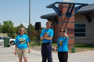 Kate Heelan, Scott Hayden, and Katie George take a little break while setting up for Walk Out On Your Job in 2008.